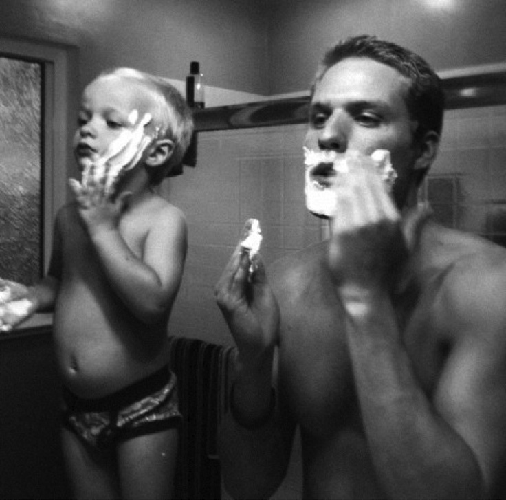 Dad and son shaving in the bathroom