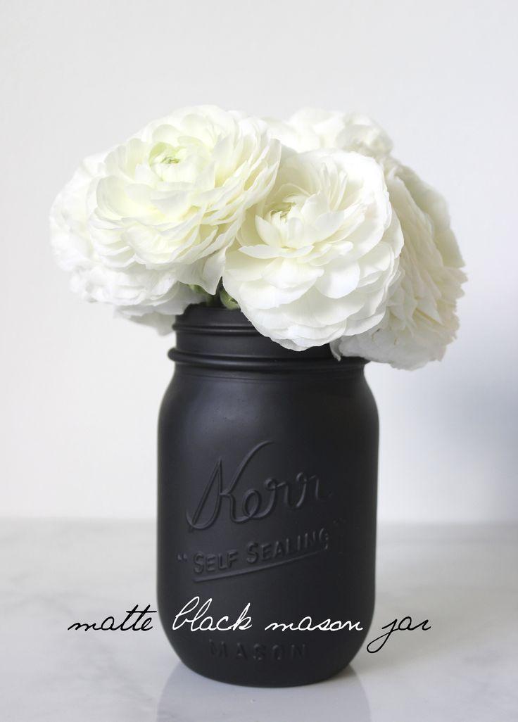 black vase, white roses