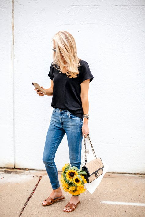 Black tee, jeans and sunflowers