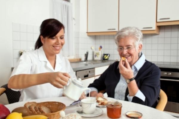 bigstock-nurse-helps-elderly-woman-at-b-25297304.jpg