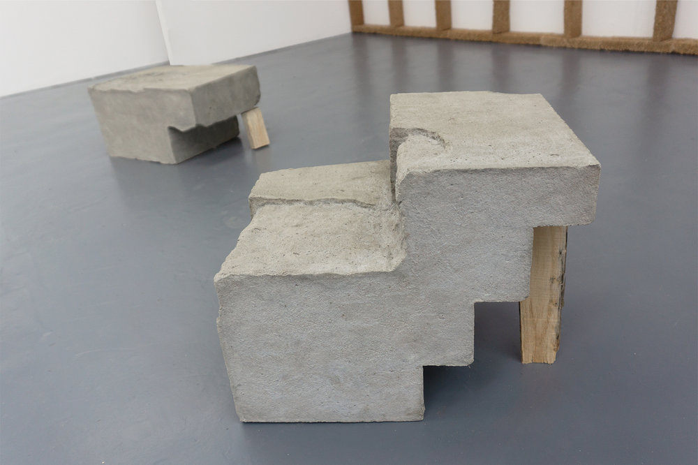 concrete block propped with hand-carved lumber