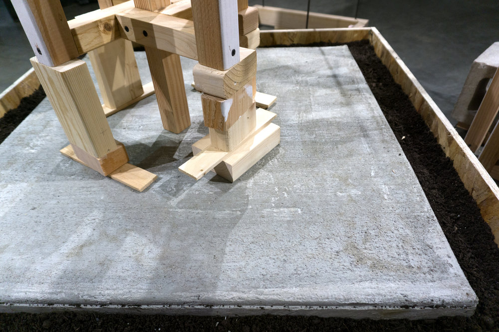 cast concrete slab and props with potting soil