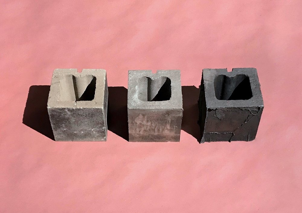 cinder block, cast aluminum cinder block made from single-use sand mold, cast iron cinder block made from same sand mold