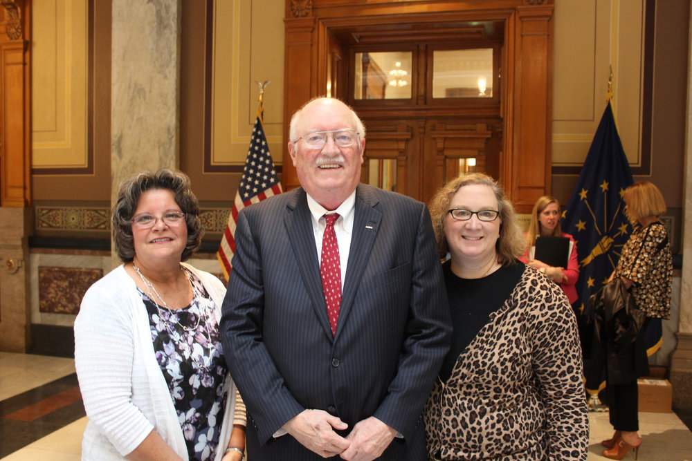 Dawn, Representative Michael Aylesworth, and Linda after the signing