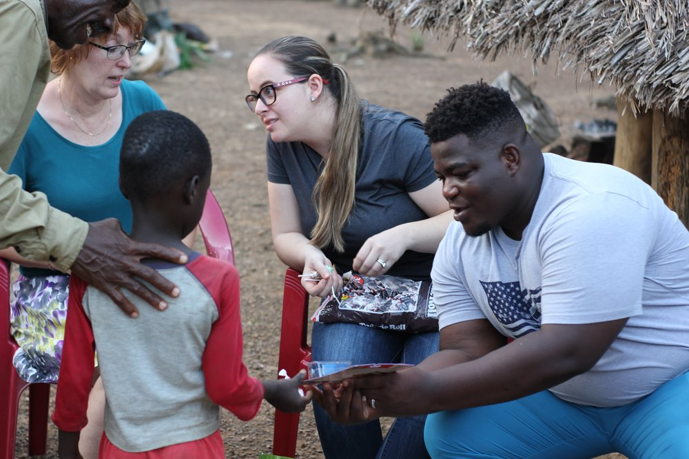 Kathy, Hillary, and Thomas gave candy and gifts to our children in Liberia