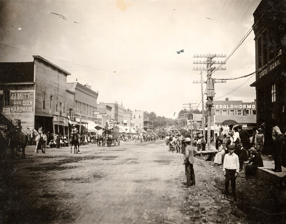 "A sign reading ""J. J. Britt and Son Hardware"" can be seen on the building on the left side of this photo. The power lines in the photo suggest it was taken in the late first or early second decade of the 20th century."