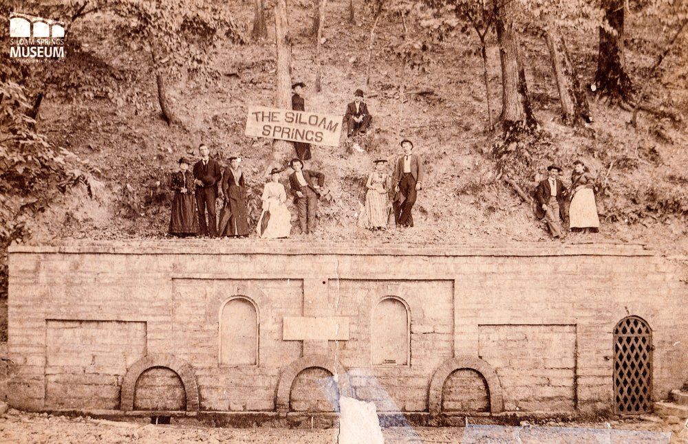 A group stands above the 1882 wall.