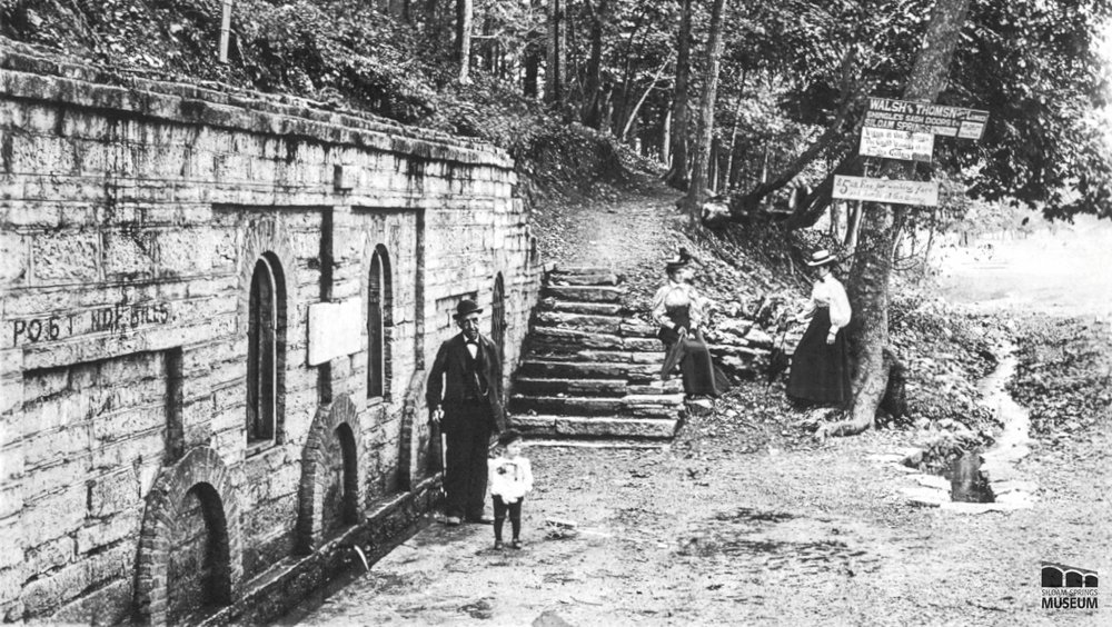 A group stands near the Siloam Spring around 1889.