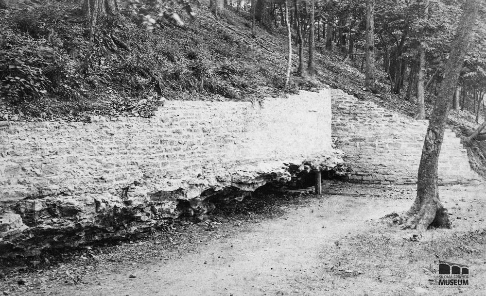 In 1897, the wall was redone, revealing the rock shelf in which the spring originally formed.