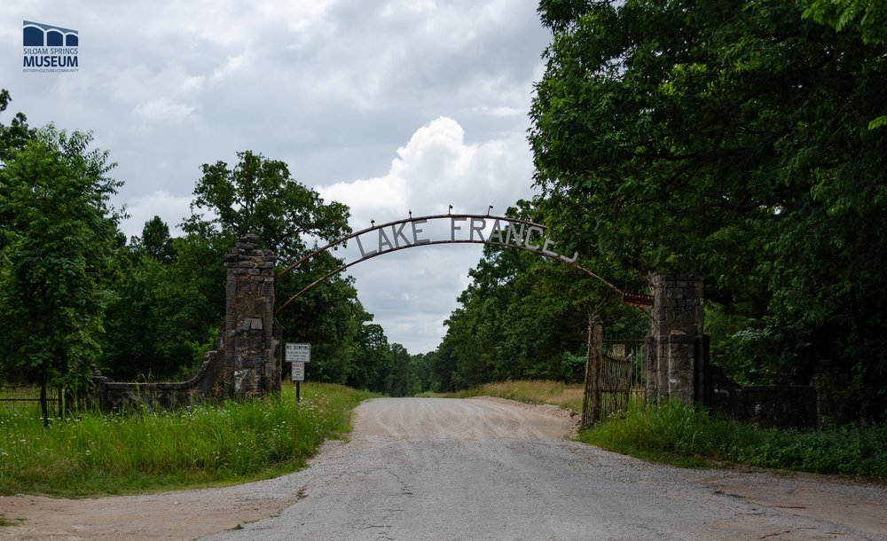 A large, overarching sign next to Highway 59 still advertises the presence of Lake Frances.