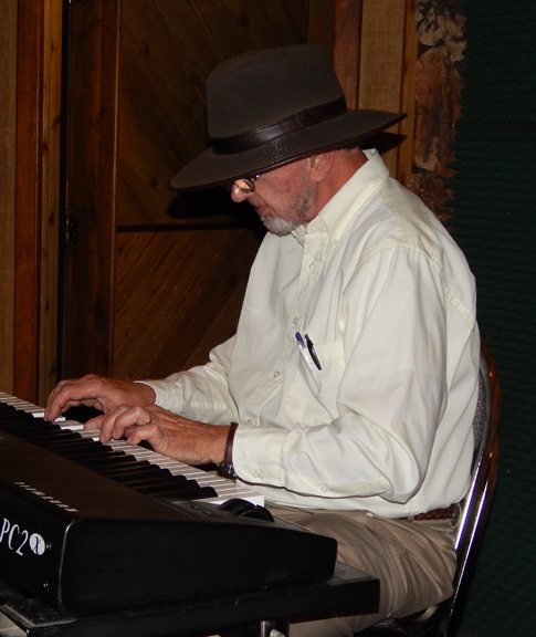 Pat Mayerchak playing keyboard on Big Arns.