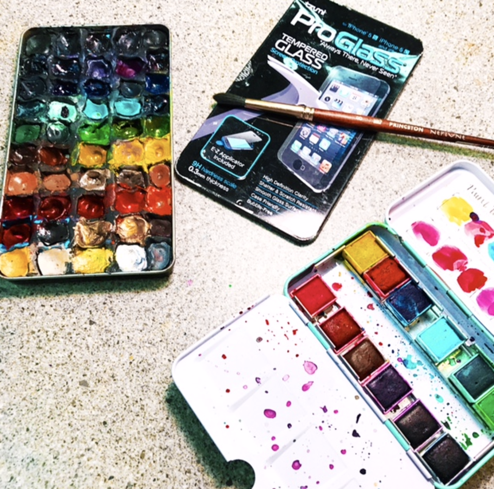 My own homemade palette (left) filled with Schmincke and Daniel Smith tube colors - I made it using Sculpey bakeable clay in an iPhone screen protector package (with slideable cover)! And the Jane Davenport Brights petite palette.