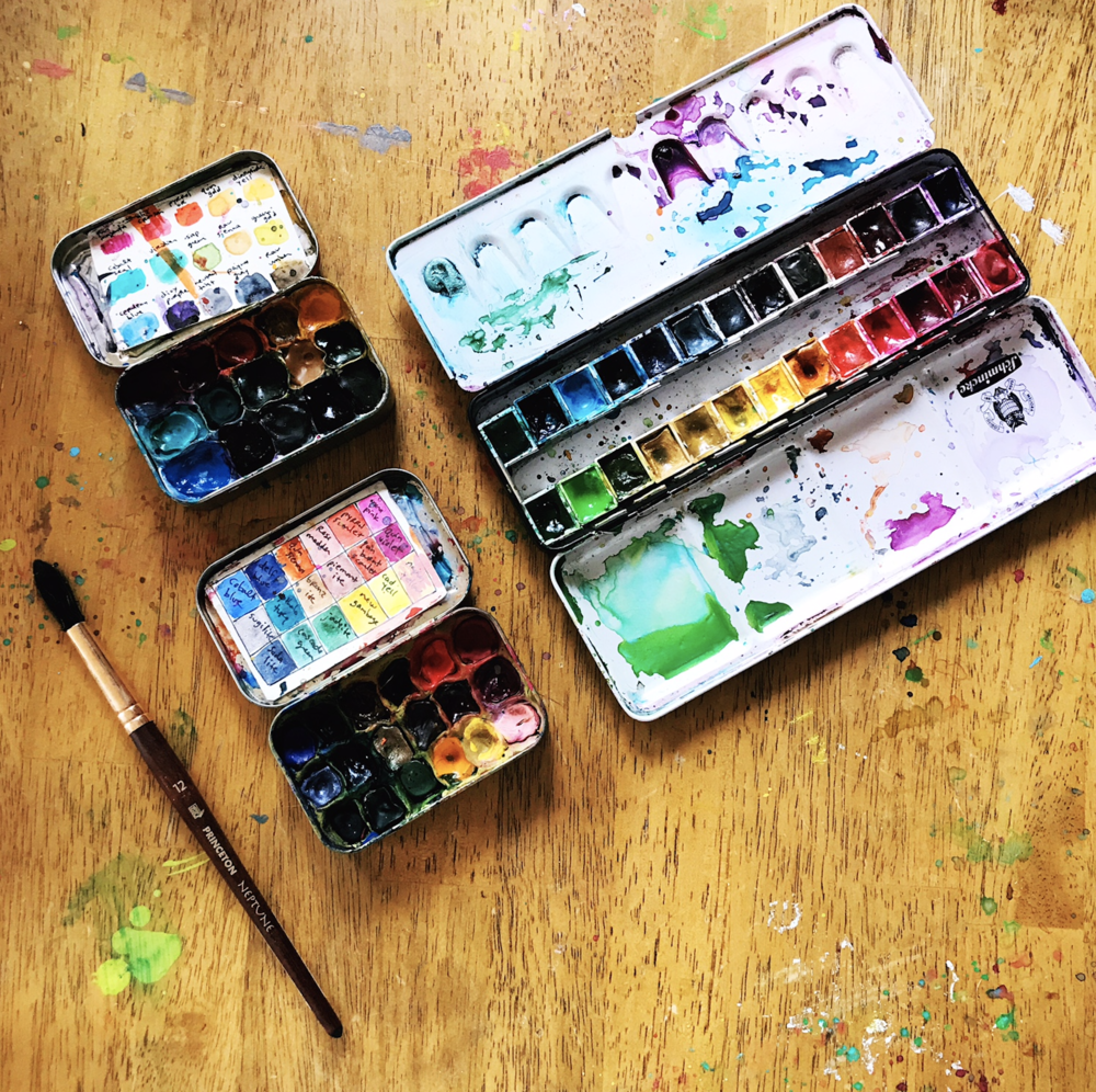 Two more handmade palettes on the left, using empty Altoids tins and Sculpey bakeable clay - Golden Qor tube watercolors on top, and mostly Daniel Smith tube watercolors on the bottom. On the right is a Schmincke palette filled with D.S. colors.