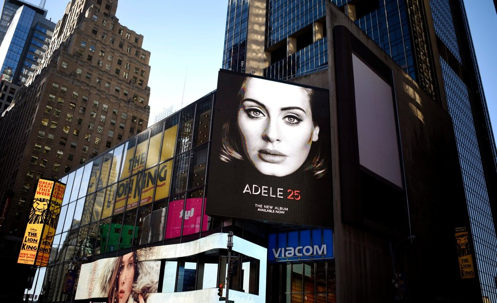 here's adele's face on a billboard in new york city. image from the new york times.