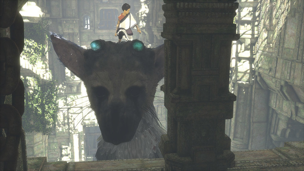 Our young protagonist balances on Trico's head to reach a new area.