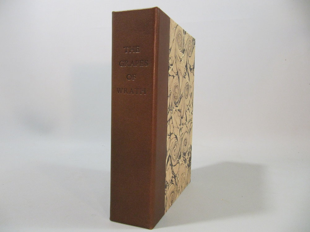The Grapes of Wrath. Clamshell box in quarter leather with microsuede lining. Blind titling across spine