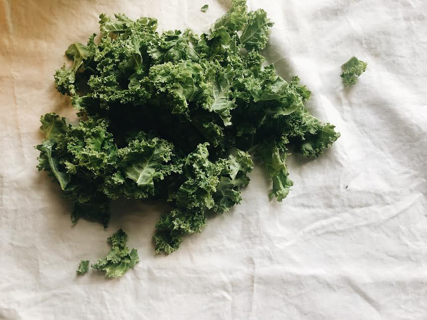 add handful of kale into mixture and cook until wilt