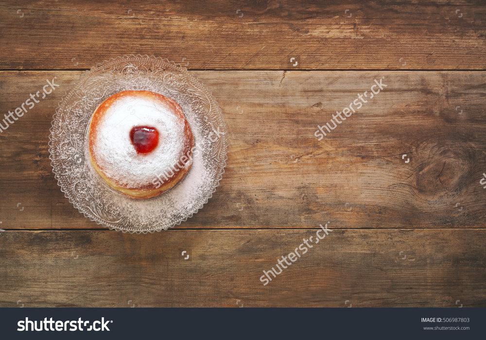 stock-photo-top-view-image-of-jewish-holiday-hanukkah-with-donut-506987803.jpg