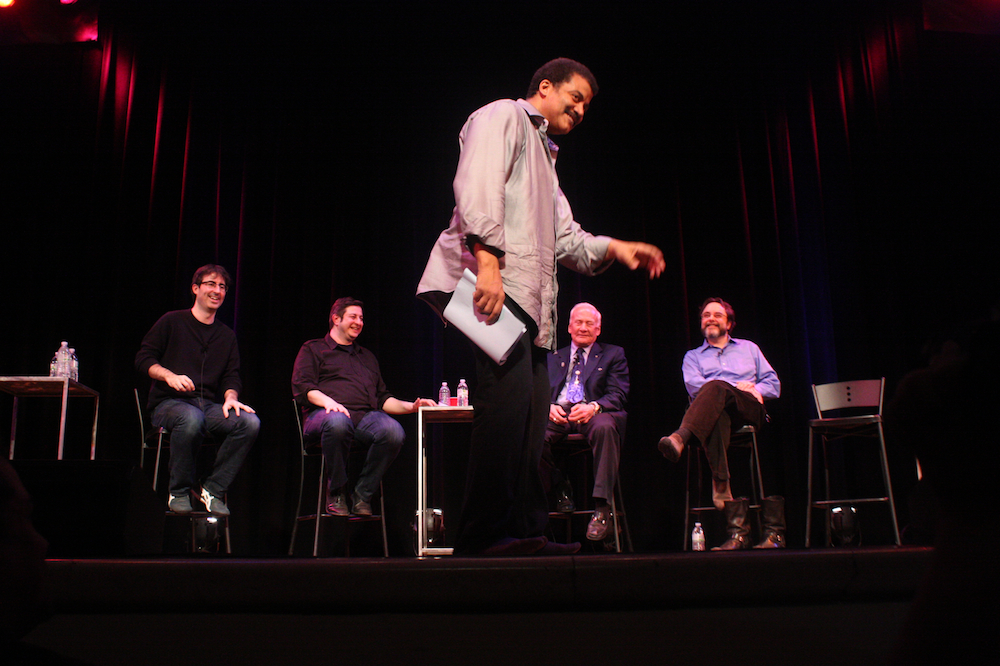 Neil deGrasse Tyson moonwalks at Town Hall in front of co-host Eugene Mirman and guests John Oliver, Buzz Aldrin and Andrew Chaikin..jpg