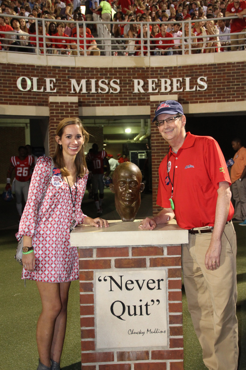 Walt Chambliss (right) and daughter, Shelby (left) pose with the Chucky Mullins memorial statue at Vaught Hemingway Stadium, Ole Miss