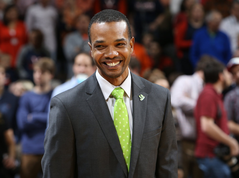 UVA assistant coach Ron Sanchez wears the CFL green tie and lapel during a Fight for Literacy Game (above).