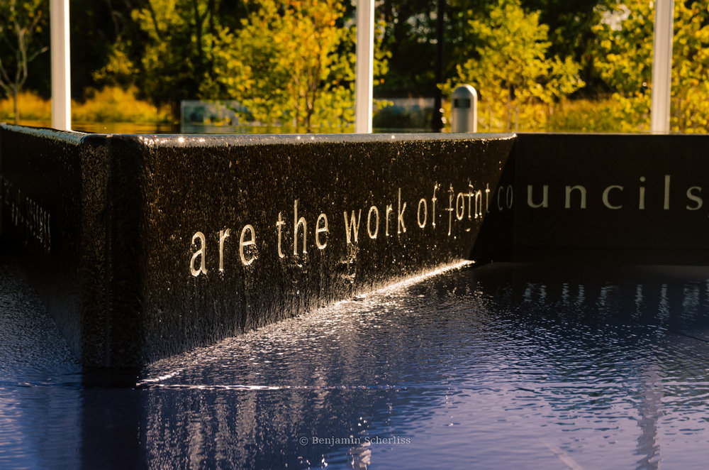 Close-up of water features and etched lettering.