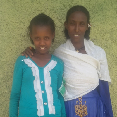 Meet Zufan. She is top of her class with a 95% average, and she loves mathematics. Her 26 year old sister Tsega, (right) never had the opportunity to go past 7th grade.The Girl Fund has allowed Zufan to continue her studies into high school and simultaneously teach Tsega about animal breeding to help her provide for her and her younger sister.Zufan's inspiration is her sister.