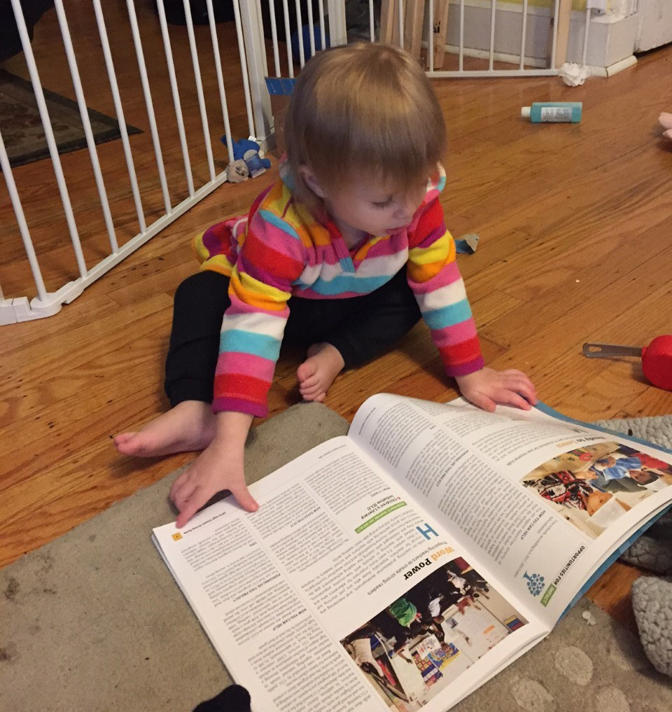 Dr. Sinderbrand's daughter Jocelyn browses the Center's High Impact Giving Guide.