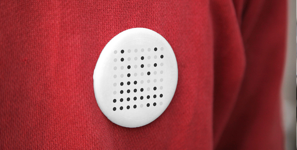 The Kin Design badge combines an air pollution sensor with GPS and Twitter