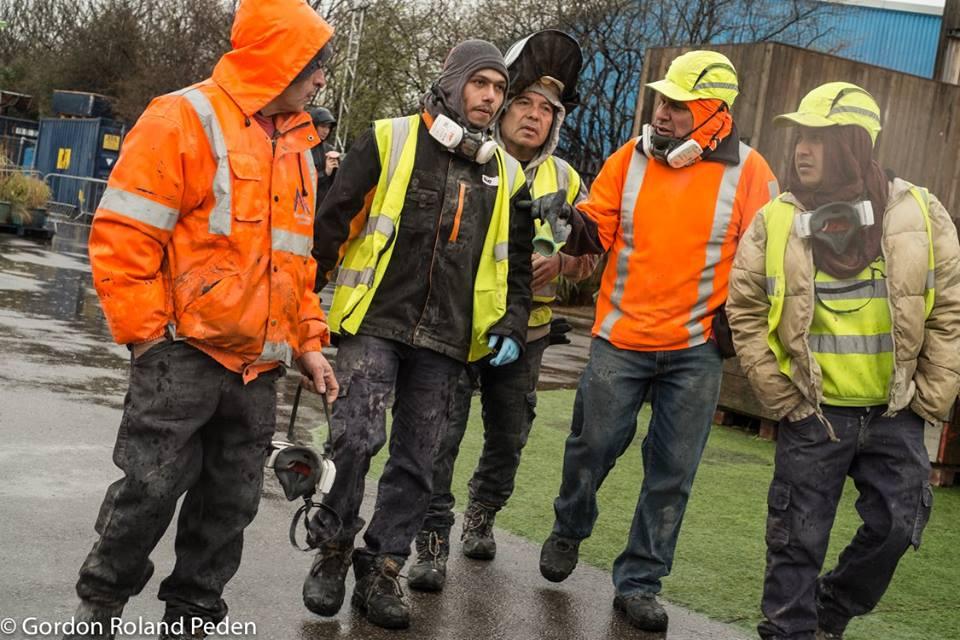 waste workers, walking, wildcat strike.jpg