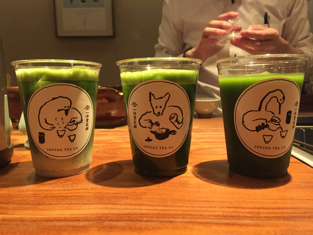 The slushy is the one on the far right. Yes, the one with the... what is that... a goose? It is hanging out with an iced matcha bear and matcha with almond milk... uh... other bird kind of thing. My super fancy thick matcha is not shown because it was already in my hands on its way to my face