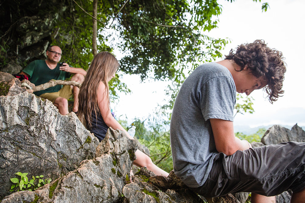 What I really remember from this hike was how difficult it was—truly more of a scramble. We wore  Keens —which are amazing sandals and closed toe as was required for this hike. But, as sandals…they allowed our feet to breathe…which we thought was super smart of us…until right after this photograph was taken and I realized that my foot was bleeding. I took off my sandal and nearly threw up because my feet were literally covered in leeches. Huge leeches. I would have taken a photograph but I was too busy being a total wuss and freaking out while being perched on a rather precarious ledge. After that…whenever we stopped we noted how quickly the teeny tiny leeches crawled towards our feet. So. Many. Leeches.