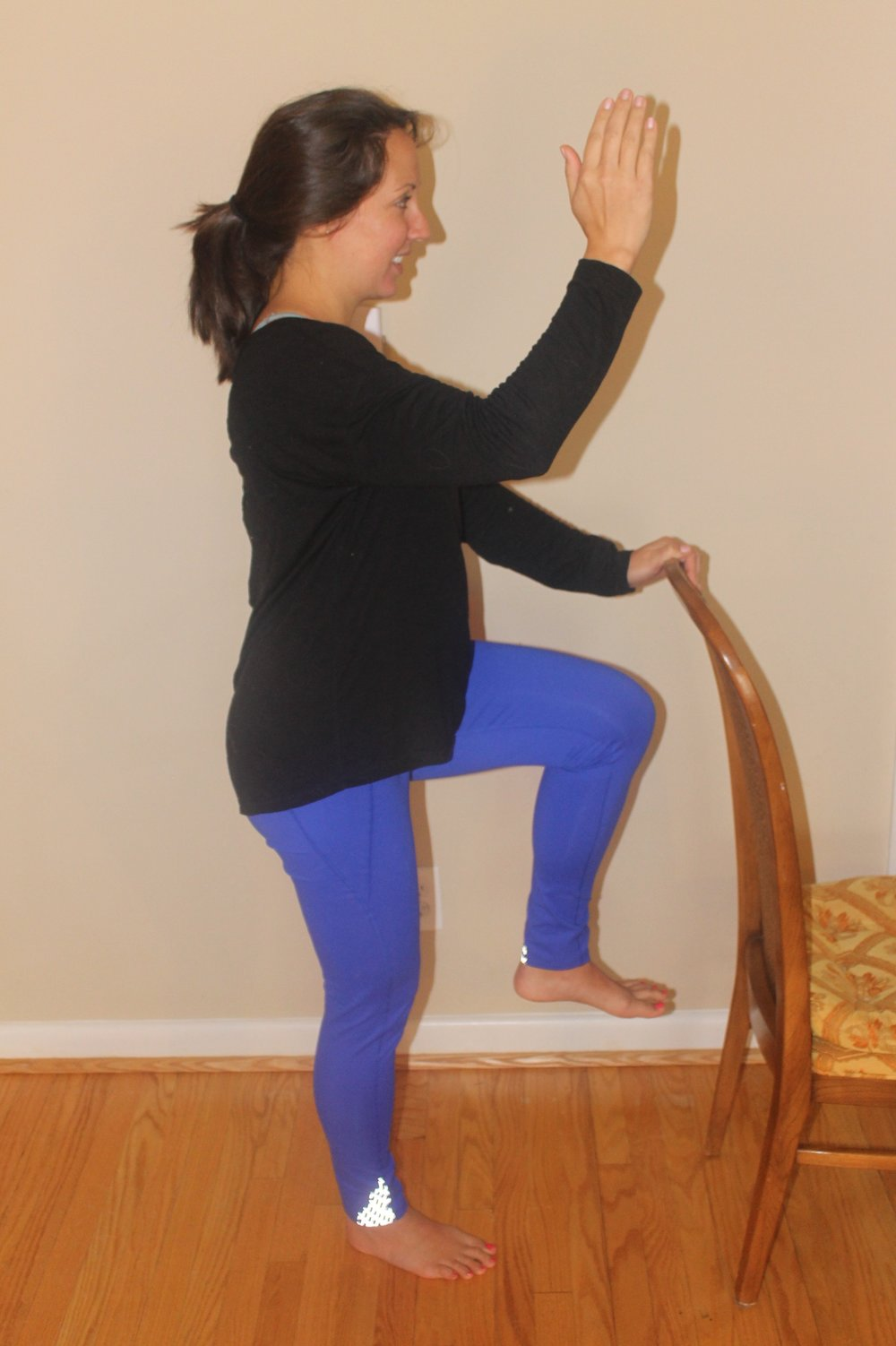 Figure 6: Dr. Heppe performs a single leg stance while holding a chair for support.