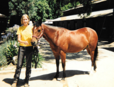 "Sarah with ""Shy Boy"" at Flag Is Up Farm, 2001."