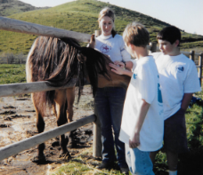 "Sarah with ""Spirit, Stallion of the Cimmaron"" at Return To Freedom, 2003."