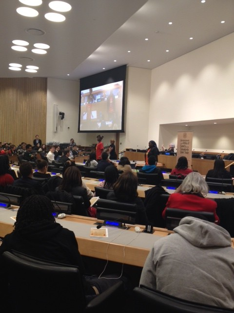 Khadija Sall ( red shirt), confidently teaching the crowd Wolof at The UN.