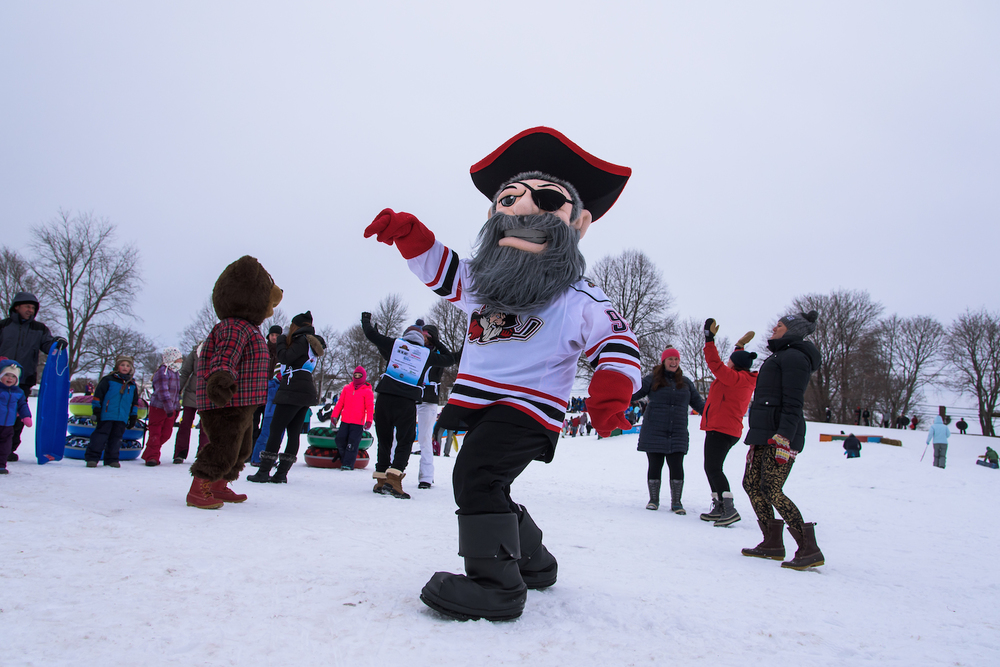 Portland Pirates mascot Salty Pete, L.L.Bear and volunteers from Take Action Portland (TAP) dance in the snow.