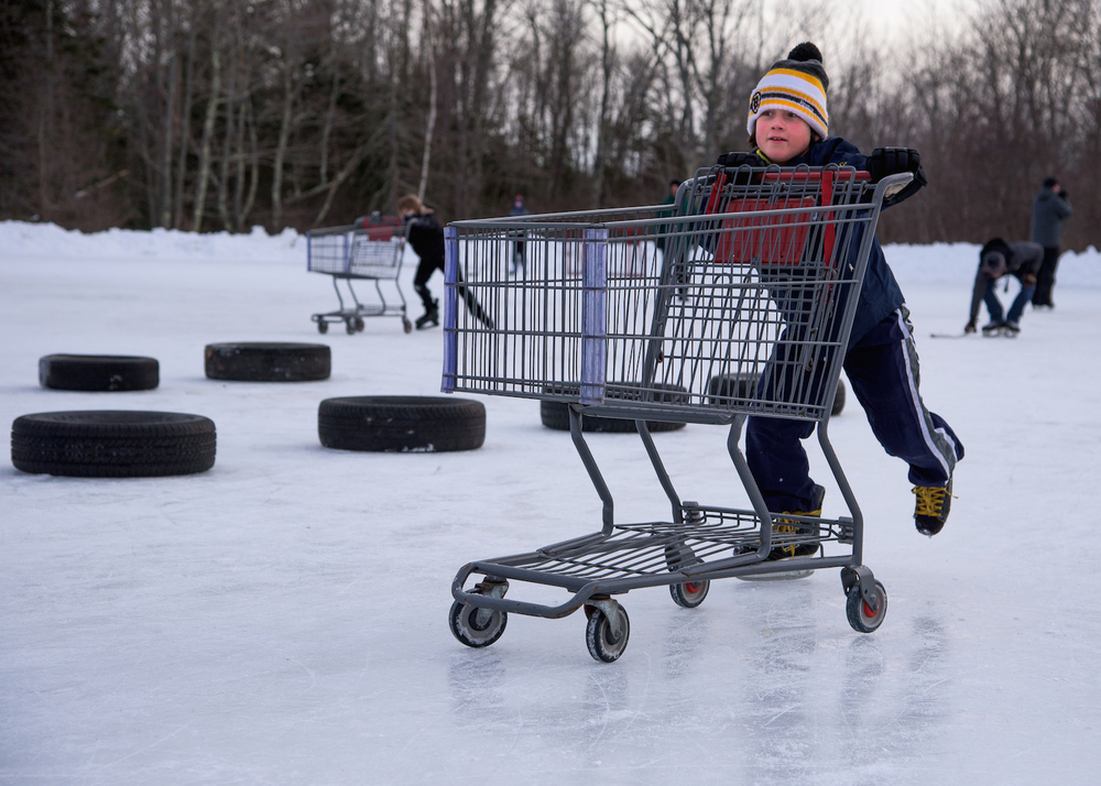 Wyatt Grondin, 9, of Scarborough pushes a shopping cart through the Obstacle Course.