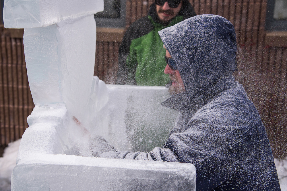 Jason Bluck of Sub Zero Ice Carvings custom-cuts a throne from a block of ice on February 15, 2016 during Scarborough WinterFest at the town's municipal ice rink.