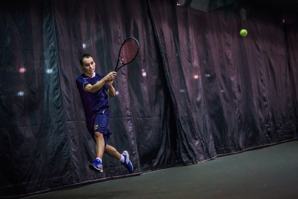 Senior Sebastian Taylor of USM serves in a match against Western Connecticut at The Racket in Portland, Saturday, April 2, 2016.