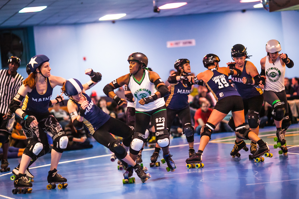 Roc City Roller Derby's Terminal Trend delivers a blow to the Maine Roller Derby squad at the Happy Wheels Skate Center in Portland,Saturday, April 2, 2016.