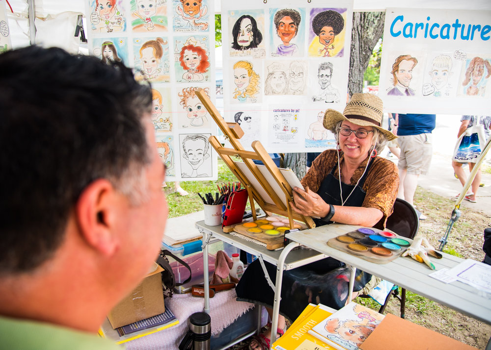 Paula Carter draws a caricature of Edward Moura of Manchester, N.H., at the 51st annual Yarmouth Clam Festival on July 16, 2016.