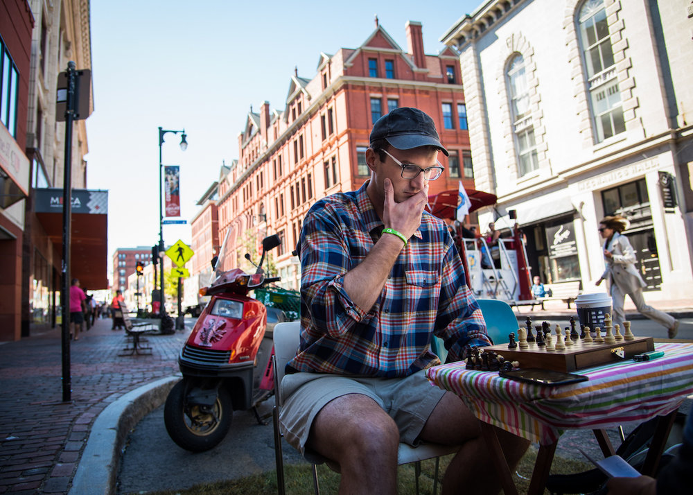 Skye Priestley of Portland plays chess in what is normally a parking space on Congress Street in Portland as part of PARK(ing) Day on Friday, September 16, 2016.