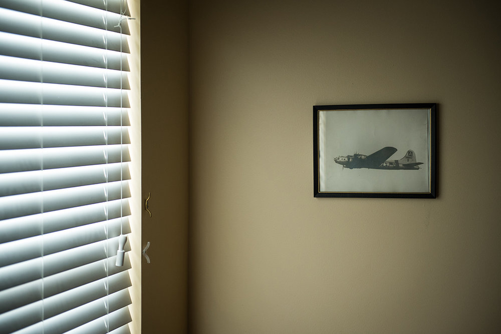 A photograph hangs in Glover's bedroom of a B-17 piloted by Glover leaving England on the way back home after the war.