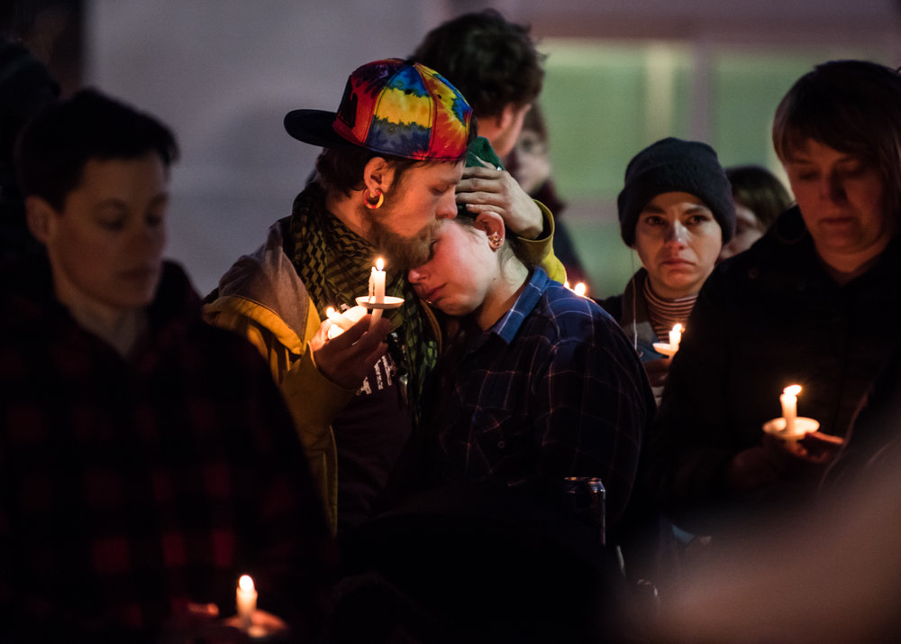 Friends of Chance David Baker mourn during a Friday, Feb. 24 vigil in Portland's Monument Square. Baker was killed by police Feb. 18; his death has prompted renewed calls for equipping police with body cameras.