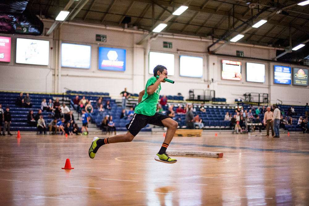 A student from King Middle School competes in a relay race during a track and field competition at the Portland Expo Saturday, March 26, 2016.