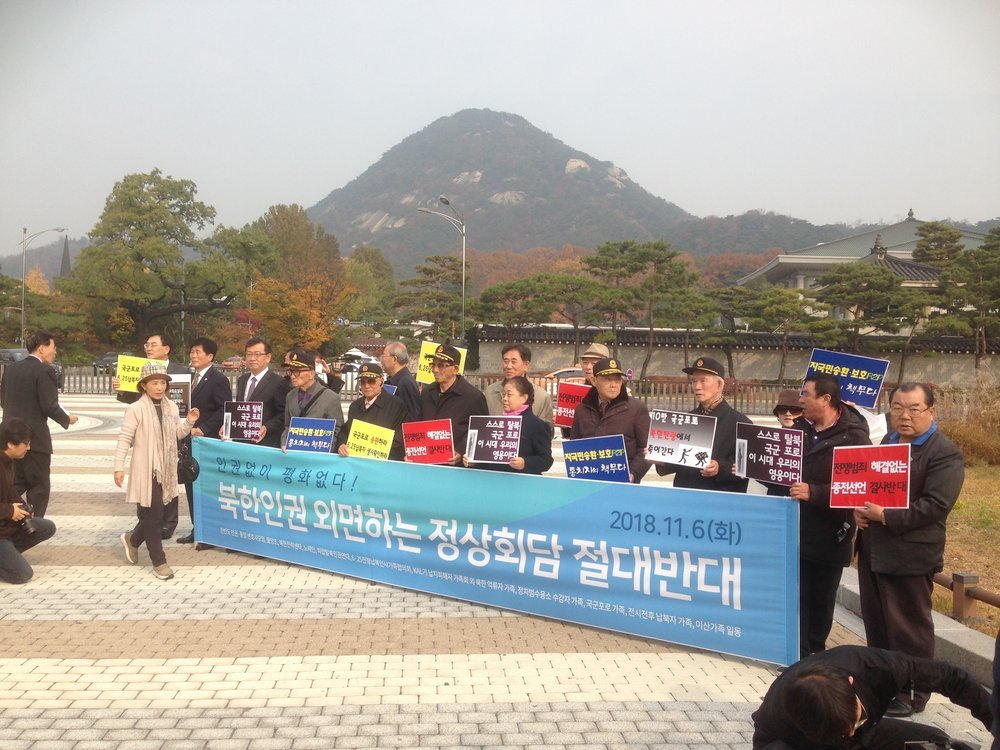 Former POWs gather for a press conference in front of the Blue House on November 6, 2018