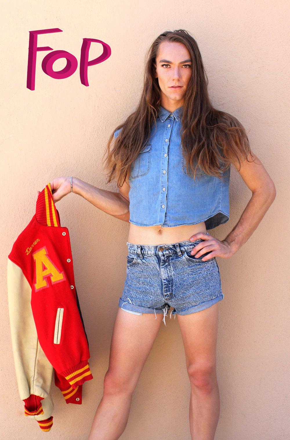 Photo by:Chloe Diaz    He Pairs Acid Wash Denim Shorties with Sleeveless Denim Halter Top and a Vintage Varsity Jacket