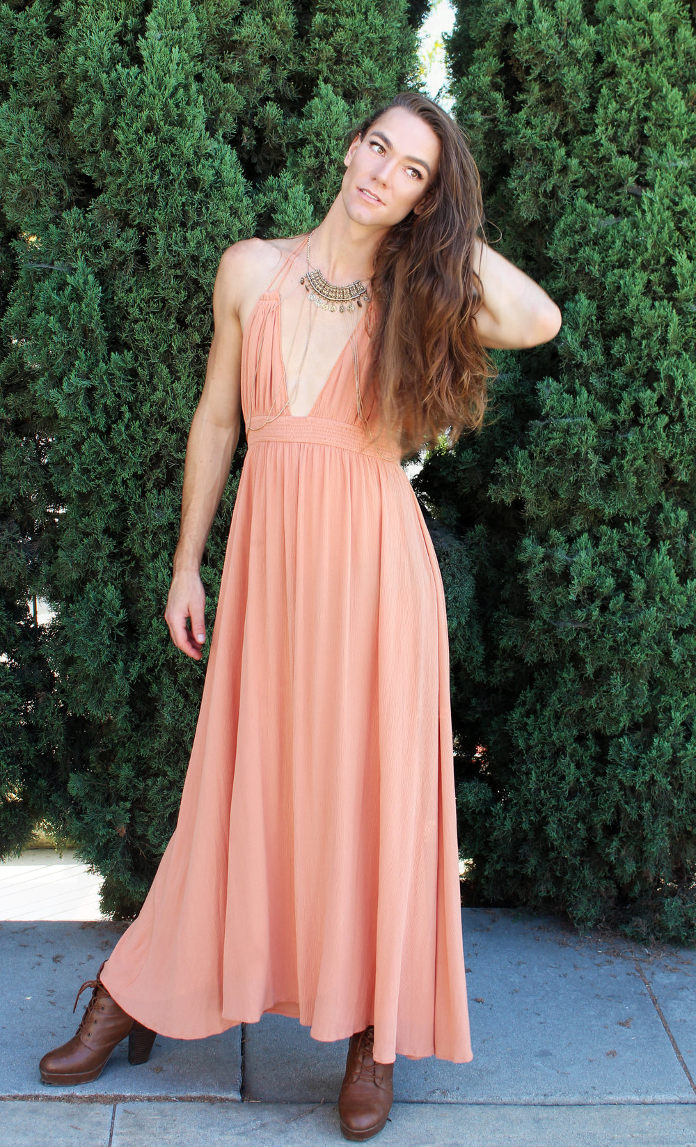Photo by: Chloe Diaz    This Look is Easy Breezy. Kyle Wears a Peach Colored Dress, Brown Booties and a Statement Necklaces to Really Make this Look Work.