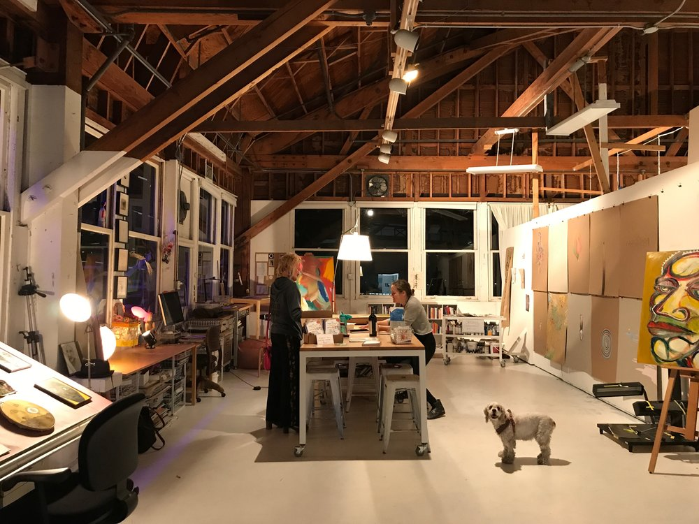 Studio in full bloom during Winter Open Studios. Elle showing her work to a client, with dog Tilly. | December 2017